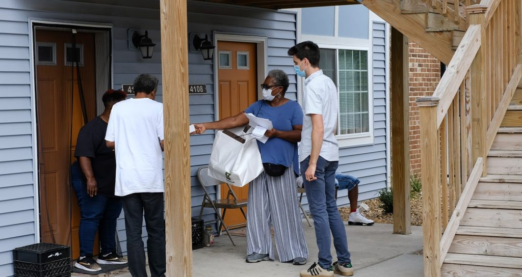 Canvassers knock on doors in North St. Louis City.